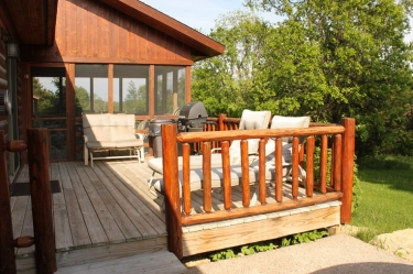 Front view of Zen Log Cabin outside deck