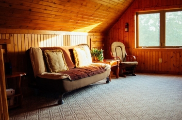 Comfy couch in the Zen Log Cabin TV room