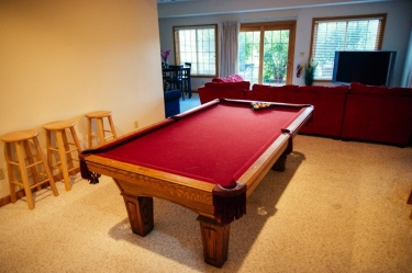 Pool table in the game room of the Luxury Getaway Cabin