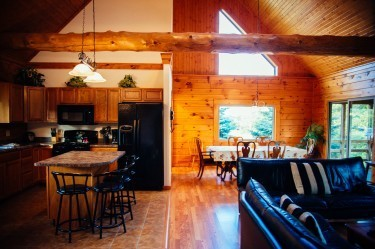 Zen Log Cabin provides a large combined kitchen and dining area